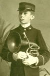 Cabinet Card of  a Boy in a Band Uniform Holding a Ballad Horn,  c. 1900's
