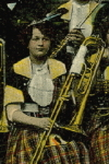 Photographic Postcard of  A Women & Men's Brass and Melodic Percussion Orchestra (1915)