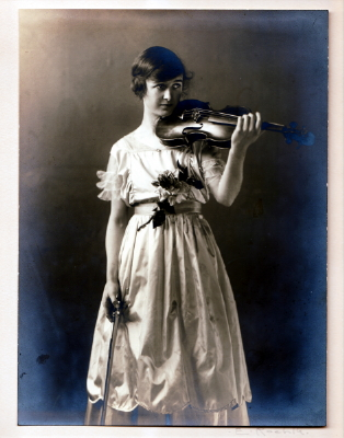 Original Photographic Print of  albumen print of a young woman holding her violin,  c. 1910