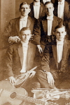 Photographic Postcard of  college band poses in formal wear,  c. 1910